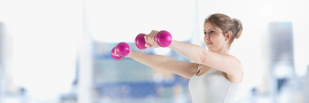 Digital composite of Slim healthy woman lifting weights