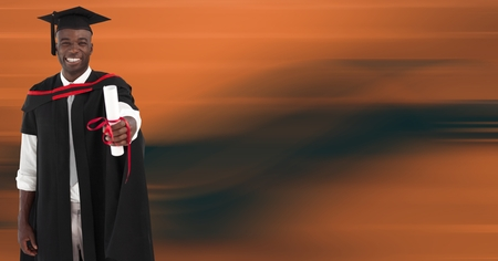 Digital composite of Graduate man smiling against blurry orange abstract background Stock Photo
