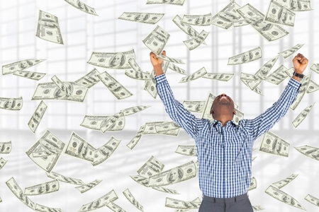 Digital composite of Excited business man with money rain against white background