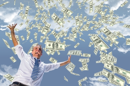 Digital composite of Excited business man with money rain against sky