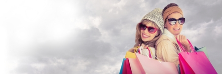Digital composite of Friends Shopping with cloudy sky transition Stock Photo