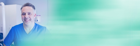 Digital composite of Dentist smiling and blurry teal transition Stock Photo