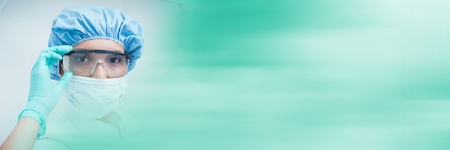 Digital composite of Dentists holding goggles and blurry green transition Stock Photo