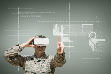 Digital composite of Military man in VR headset touching interface against green background with interfaces