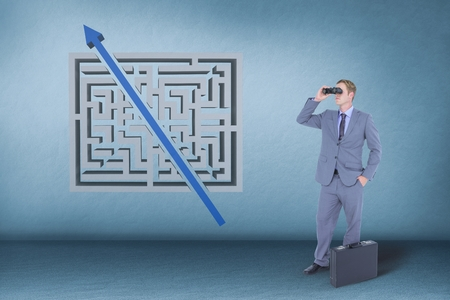 Digital composite of Man looking through binoculars against blue background with a maze