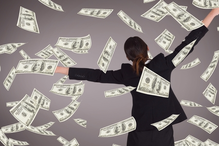 paper sheet: Digital composite of Excited business woman with money rain against purple background Stock Photo