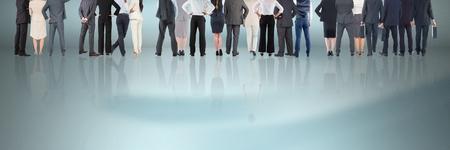 Digital composite of Group of Business People standing on reflective surface Reklamní fotografie