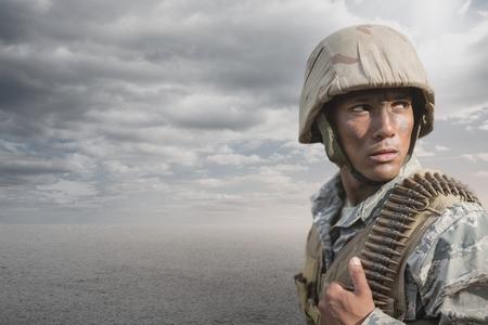 Digital composite of Soldier man standing against desert background Stock Photo