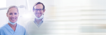 Digital composite of Two dentists smiling and blurry white transition