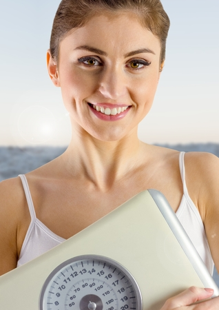 horizon over water: Digital composite of Slim healthy woman holding weighing scales