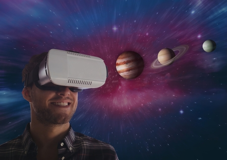 side viewing: Digital composite of happy man in VR headset looking at 3D planets against galaxy background Stock Photo