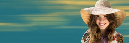 Digital composite of Close up of woman in summer hat against blurry yellow and blue background Stock Photo