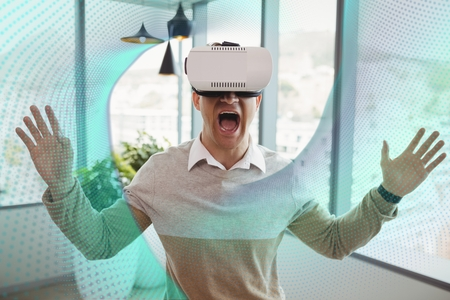 career fair: Digital composite of Excited man in VR headset looking at interface