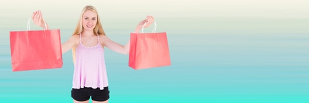 Digital composite of Shopper with red bags against blurry light blue background Stock Photo