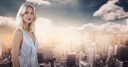 range of motion: Digital composite of Woman with grey dress against skyline with clouds