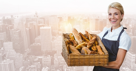 Digital composite of Bakery owner with basket against blurry skyline