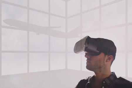 bowing head: Digital composite of Man in VR headset looking at a plane against white background