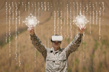 Digital composite of Military man in VR headset touching interfaces against field background with interfaces Stok Fotoğraf