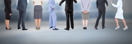 white coat: Digital composite of Group of Business People standing with moody background Stock Photo