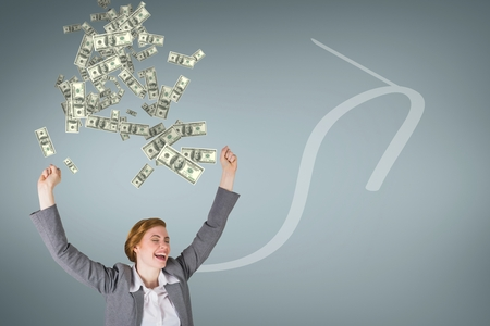 Digital composite of Excited business woman with money rain against blue background with arrow
