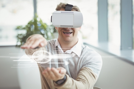 reliable: Digital composite of Happy man in VR headset touching interface with flares
