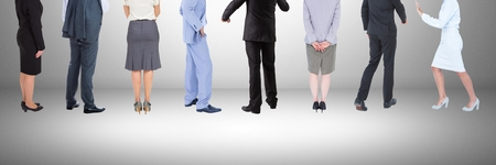 well dressed woman: Digital composite of Group of Business People standing with  grey vignette