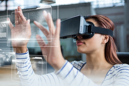 Digital composite of Woman in VR headset touching interfaces