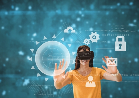 Digital composite of Happy woman in VR headset touching interfaces against blue background with flares