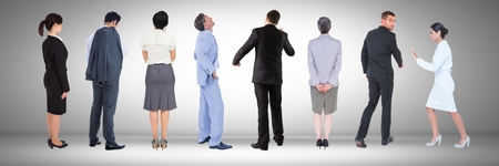 asian business: Digital composite of Group of Business People standing with grey vignette Stock Photo