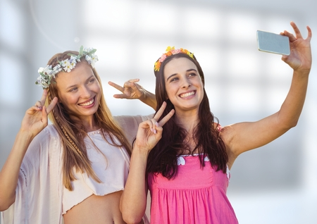 Digital composite of Women taking casual selfie photo in front of blurred background