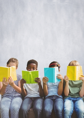 Digital composite of Group of children reading books in front of bright background