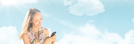 Digital composite of Millennial woman texting against Summer sky with flare