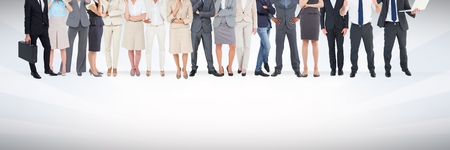 carrying: Digital composite of Group of business people standing in front of blank grey background
