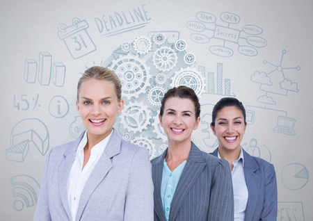 Digital composite of Group of businesswomen in front of business graphics Stock Photo