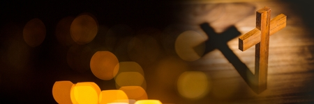Digital composite of Standing cross and yellow black bokeh transition