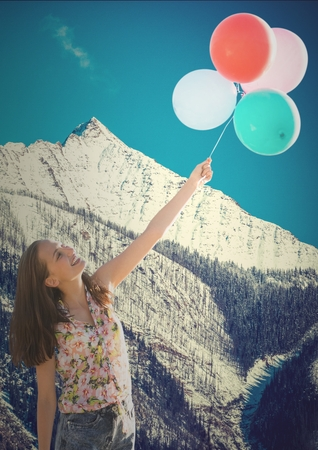 Digital composite of Millennial woman with balloons against snowy mountain