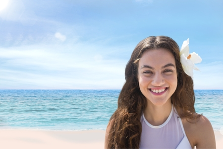repetition: Digital composite of Woman at the beach smiling