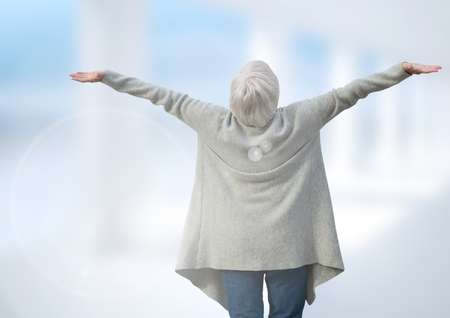 Digital composite of Old Woman practicing casual Mindfulness in front of blurred background