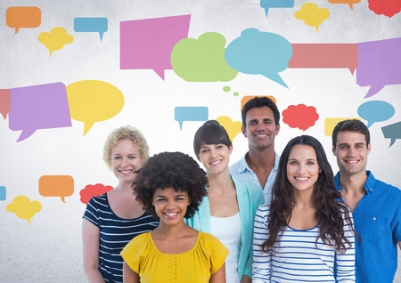 Digital composite of Group of people standing in front of colorful chat bubbles Standard-Bild