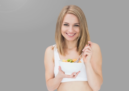 career fair: Digital composite of Portrait of woman eating salad with grey background