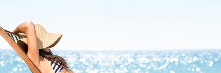 Digital composite of Woman sunbathing against blurry horizon