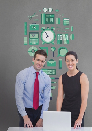 Digital composite of Happy business people at a desk using a computer against grey background with green graphic