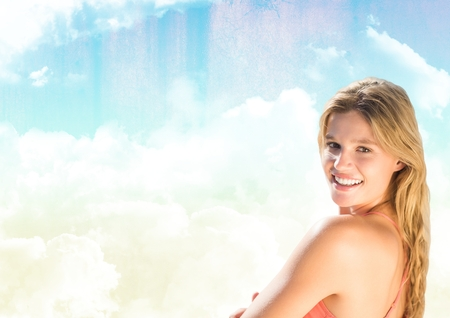 Digital composite of Millennial woman smiling against Summer sky