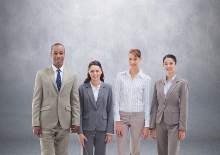 Digital composite of Group of business people standing in front of blank grey background