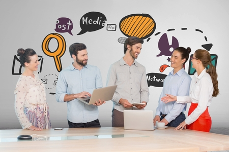 Digital composite of Happy business people at a desk using computers and tablets against white background with graphics