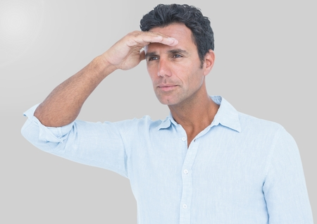 Digital composite of Portrait of Man looking in distance with grey background Stock Photo