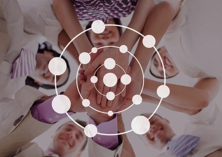manos unidas: Digital compuesto de icono de círculo de conexión contra amigos foto