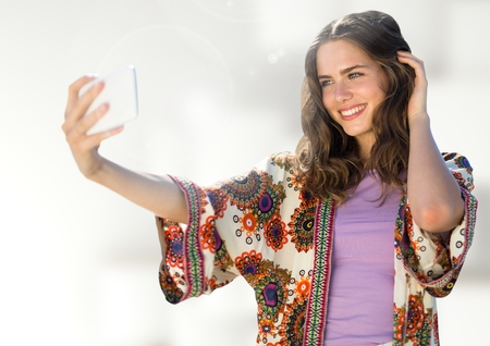 Digital composite of Woman taking casual selfie photo in front of blurred background