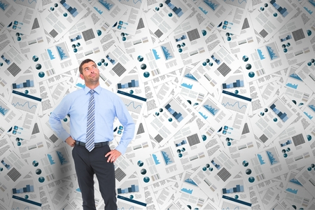 Digital composite of Confident businessman standing thinking with business newspapers in background