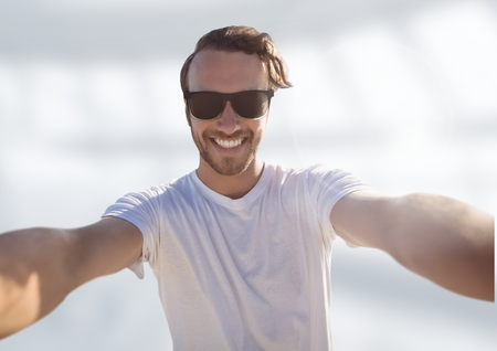Digital composite of man taking casual selfie photo in front of blurred bright background